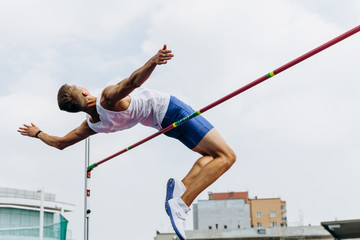 high jump athlete jumper successful attempt in competition