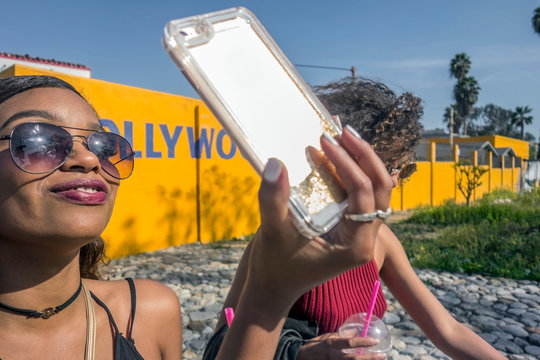 Two young women taking selfie in Hollywood, Los Angeles, California, USA