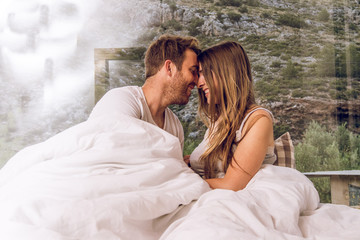 Couple of guy and girl in bed happy and in love.Concept of love between couples