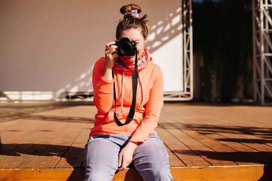 Woman on stage, taking photograph