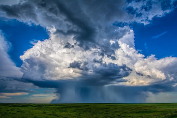 Beautiful supercell storm drops rain and hail in microburst near Chappell, Nebraska, rain foot curls upward