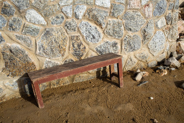 Wooden chair with Stone fence, Thailand