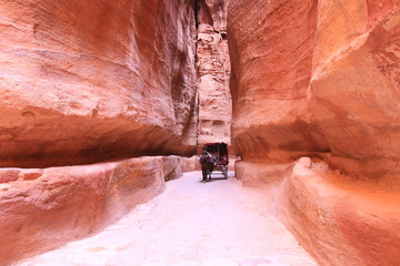The Siq, the narrow slot-canyon that serves as the entrance passage to the hidden city of Petra, Jordan