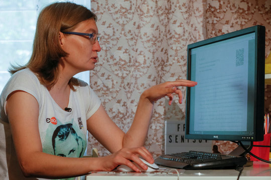 Natalya Kaplan, cousin of Ukrainian film director Oleg Sentsov, shows his letter on a computer monitor during an interview with Reuters in Kiev