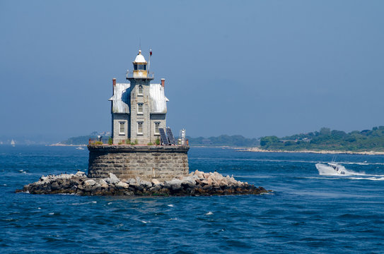Race Rock Light is a lighthouse on Race Rock Reef, a dangerous set of rocks on Long Island Sound southwest of Fishers Island, New York and the site of many shipwrecks.