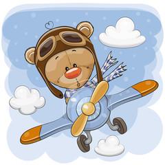 Fototapeta Cute Teddy Bear is flying on a plane