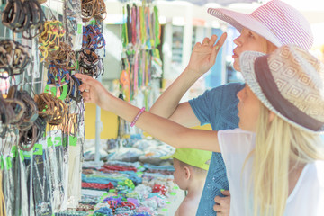 Mother and daughter choose jewelry.