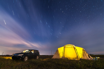 Subaru Forester at beach camping under stars