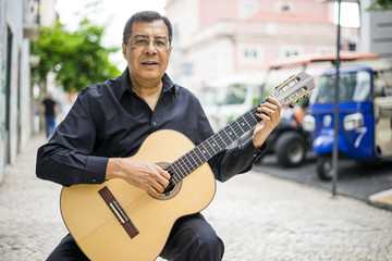 Aoustic guitar player on the street of Alfama in Lisbon, Portugal