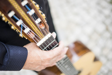 Musician holding his acoustic guitar