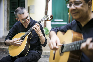 Two fado guitarists with acoustic and portuguese guitars