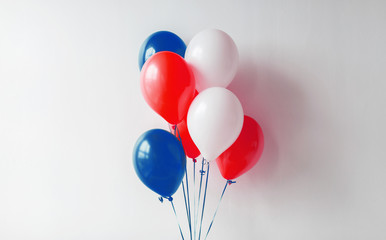 holidays and decorations concept - red, white and blue air balloons for 4th of july or birthday party