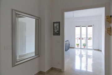 Modern apartment. White corridor and room