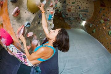 A woman trains to climb.