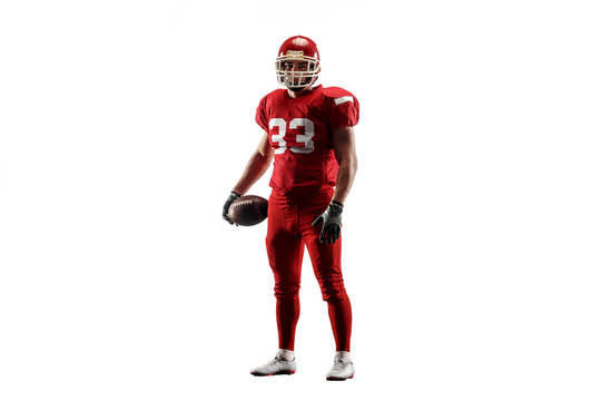 Active one american football player isolated on white background. Fit caucasian man in uniform posing over studio background. Human emotions and facial expressions concept