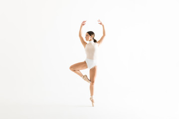 Ballerina Rehearsing On One Leg With Arms Raised