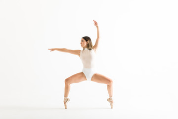 Energetic Female Dancer Performing Ballet Squat