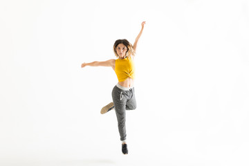 Fit Young Woman Dancing Over White Background