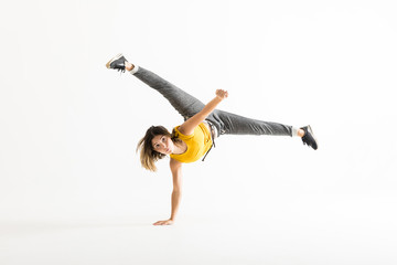 Attractive Young Woman Doing A Freeze Breakdance Move
