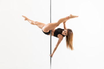 Sexy Woman Practicing Some Moves On Pole Wall mural