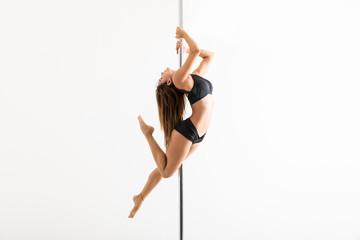 Obraz Pole Fitness Expert Flaunting Dance Moves In Studio - fototapety do salonu