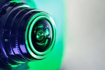 Side view of the camera with green backlight. Horizontal photography