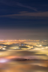Long exposure with the magic of light, dense fog and houses in the night Artwork done elaborately, landscape and nature Great images for printing, advertising, travel magazines and more