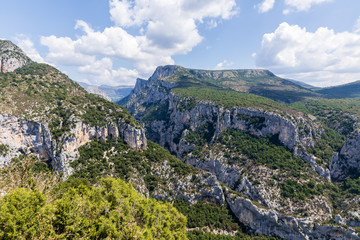 panoramic view of majestic rocky mountains with green vegetation in provence, france