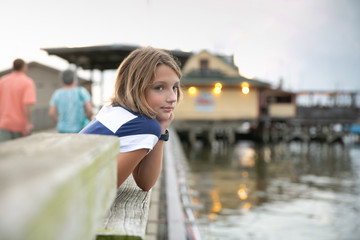 Child Tween Girl on Pier Looking out to Sea Pondering Future