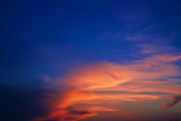 golden clouds against blue sky