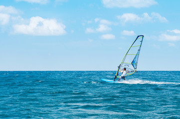 Phuket Patong beach windsurfing sport in hot summer sun