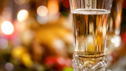 Closeup image of beautiful crystal glass with champagne on dining table