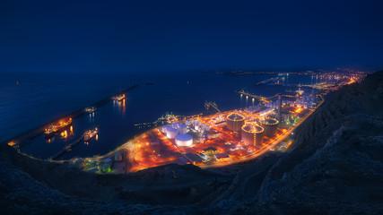 Panorama of industrial factory illuminated at night
