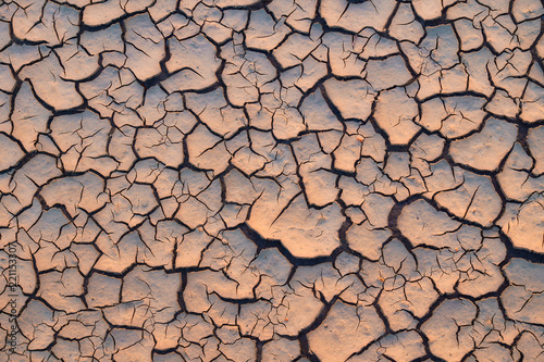 arid and dry cracked land beacause global warming stock photo and