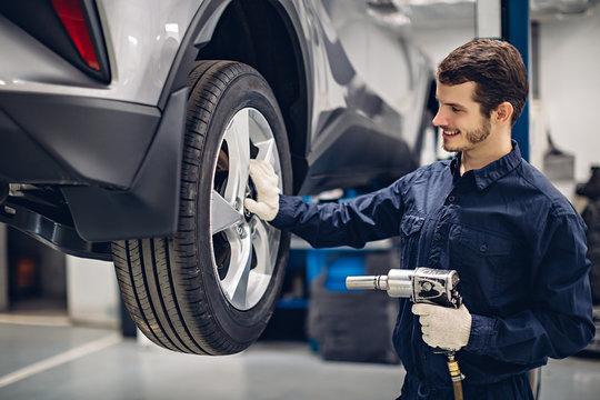 Auto car repair service center. Mechanic at work
