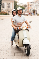 Portrait of a happy young couple in helmets