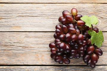 Red grape on grey wooden table
