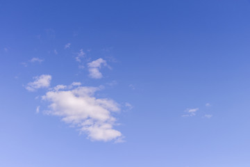 Blue sky and white fluffy tiny clouds background and pattern