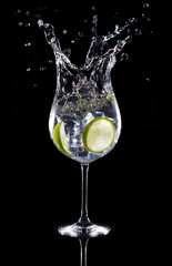 gin tonic cocktail splashing isolated on black background