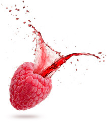 Wall Mural - red juice splashing out of a raspberry isolated on white background.