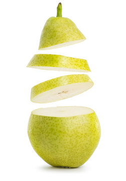 flying slices of pear isolated on white background