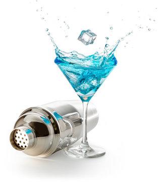 steel shaker and splashing blue martini isolated on white background