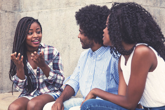 African american woman telling story to friends
