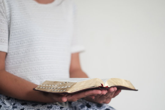The woman is reading the Bible background image.