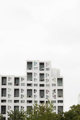 Minimalist architecture. Residential tower with bright light and white color.