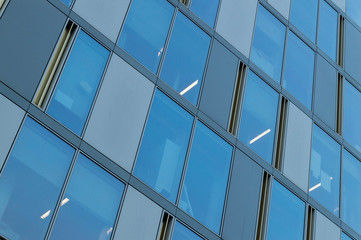 Business architecture building with glass windows and dynamic lines