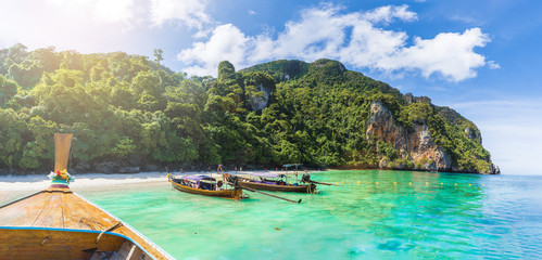 Wall Mural - Traditional long tail boat on famous Monkey beach, Phi Phi Islands, Thailand