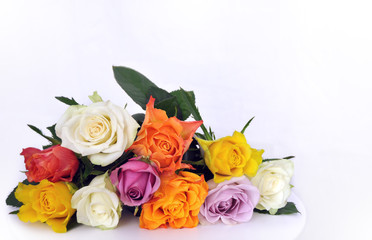 Bouquet of colored roses on a table (copy space).