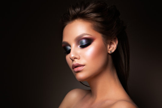 Close-up of beautiful female face with colorful make-up and lips, eyes closed