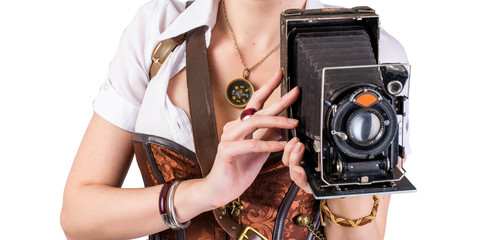 Portrait of a beautiful steampunk girl with camera